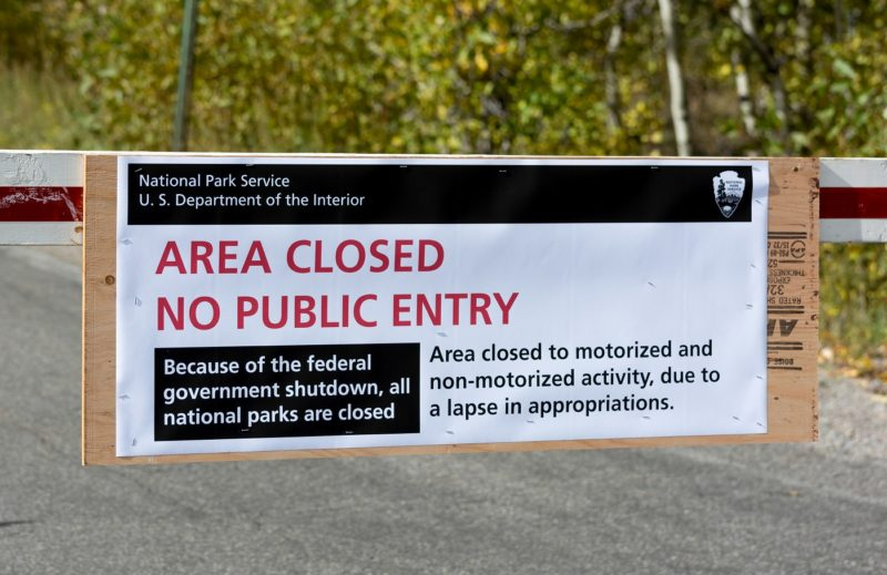 US National Parks closure sign at entrance to the Grand Tetons National Park in Wyoming